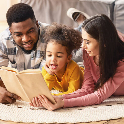 Dad-and-Mom-reading-to-child