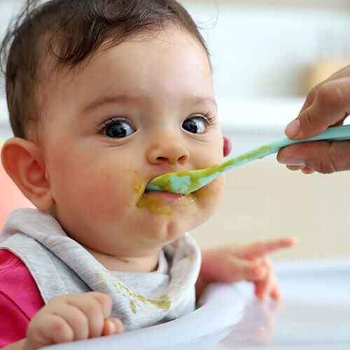 Spoon-feeding-little-girl