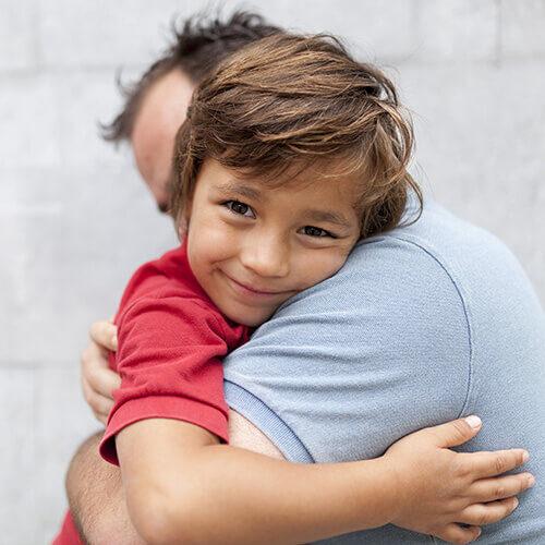 boy-hugging-dad